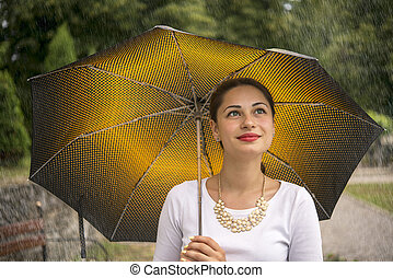 girl under an umbrella in the rain