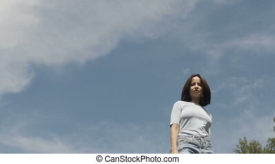 Girl underblue sky