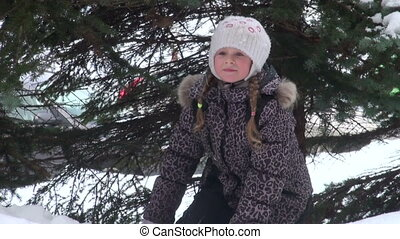 Girl under the tree in winter forest