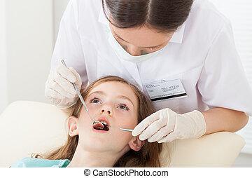Girl Undergoing Dental Treatment