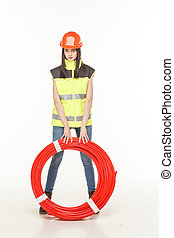 girl uniform coil pipe workman - girl in the uniform of a...