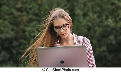 Girl Uses Laptop in Park