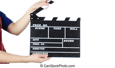 Girl uses movie production clapper board, on white
