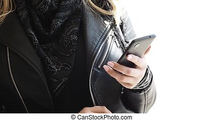 girl uses smartphone messenger reading or watching social...