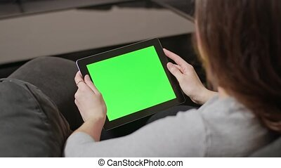 Girl Using Digital Tablet PC with Blue Screen