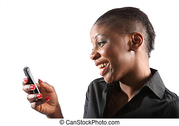 Beautiful smiling black woman using mobile phone on a white background