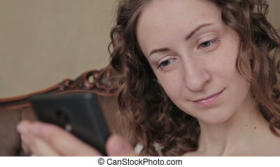 Girl using mobile phone - close up face view