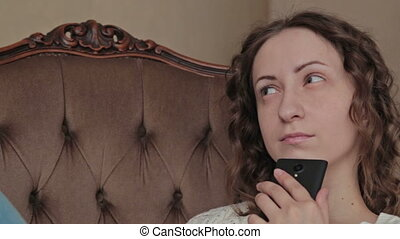 Girl using mobile phone - think about something