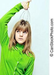 Teen girl enjoying using head scalp massage