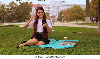 girl using smartphone outdoors