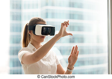 Girl using swipe and stretch gesture in VR glasses