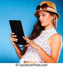 girl using tablet computer e-book reader. - Technology...