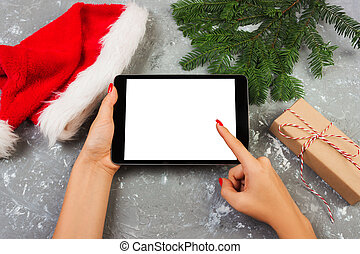 girl using tablet technology in home, person holding computer on background Christmas decoration, female hands texting, mockup templates