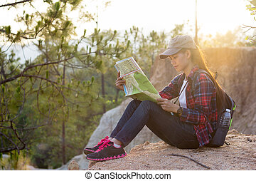Girl viewing mountain trekking map