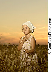 Girl vilager in field