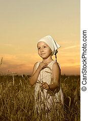 Girl vilager in field