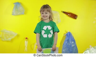 Girl volunteer holding painted picture of Earth. Plastic trash nature pollution. Save ecology