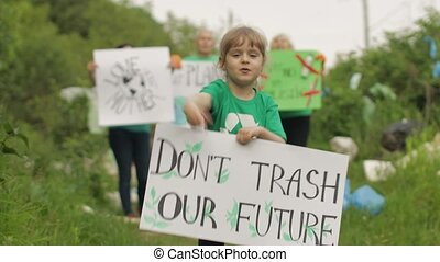 Girl volunteer holds protesting poster Don't Trash Our ...