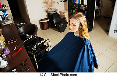 Girl waiting for hairdresser in hairdressing salon