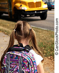 girl waiting for school bus