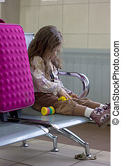 Girl waiting in airport for departure