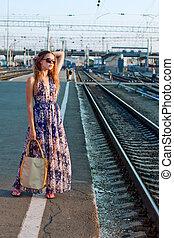 Girl waiting train on the platform