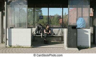 Girl waits the train on railwaystation