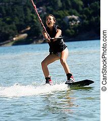 Girl wakeboarding
