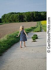 girl waking in fields