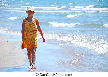 Girl walk beach