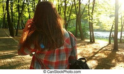 Girl walk park sunset forest