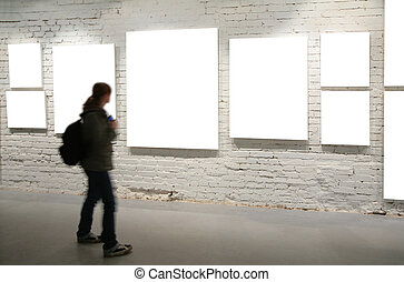Girl walk through frames on a brick wall