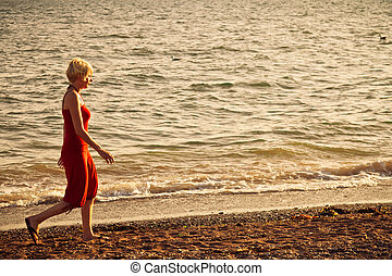 Girl walking along the beach