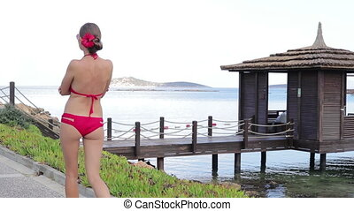 Girl walking along the promenade on vacation - Sexy young...