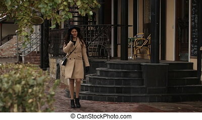 Girl walking and talking on the phone