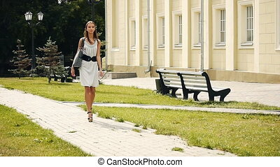Girl walking down the street slow m