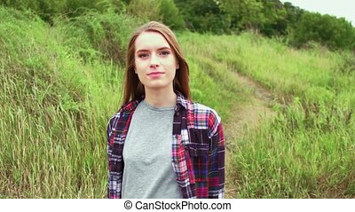 girl walking in a field alone