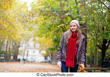 Girl walking in park on a fall day