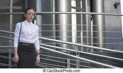 Girl walking in the city. white blouse business style.