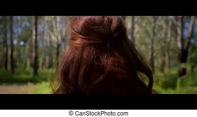 Girl walking in the forest and smiling cinema view