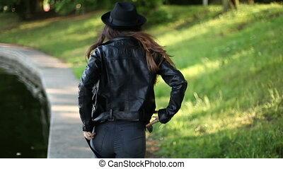 Girl walking in the park. summer