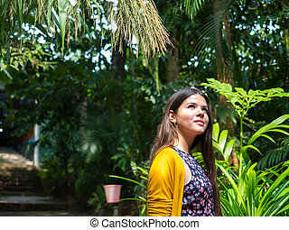 Girl walking in tropical forest