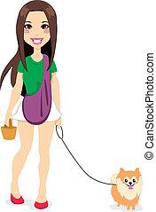 Girl Walking Little Pomeranian - Beautiful young girl...