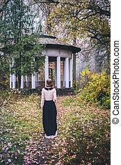 Girl walking on a gloomy autumn morning
