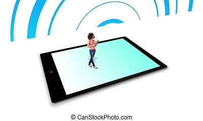 Girl walking on and using tablet pc