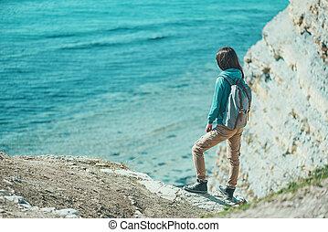 Girl walking on coast in summer