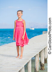 Girl walking on jetty