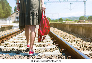 Girl walking on rail road track