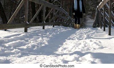 Girl walking on snow.