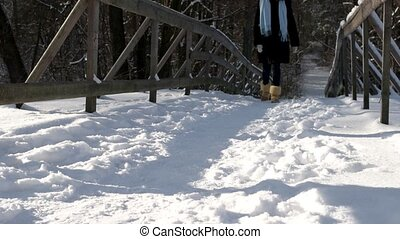 Girl walking on snow.
